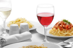 A glass of red wine served with italian pasta royalty free stock photos