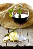 Glass of red wine and slices of cheese Royalty Free Stock Images