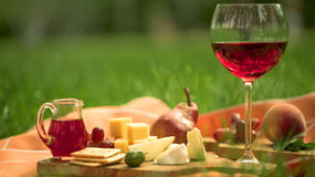 Glass of red wine with a snacks royalty free stock photography