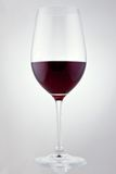 Glass of red wine in soft white light Stock Images