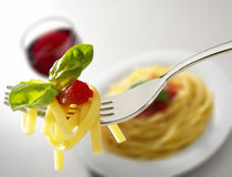 Glass of red wine and  spaghetti Royalty Free Stock Photography