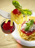 Glass of red wine and  spaghetti Royalty Free Stock Photo
