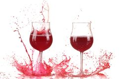 Glass with red wine splash. Isolated on white background royalty free stock images