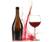 Glass with red wine splash. Isolated on white background stock photos