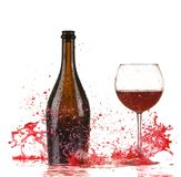 Glass with red wine splash. Isolated on white background stock image