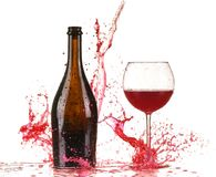 Glass with red wine splash. On white background royalty free stock image