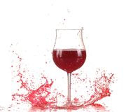 Glass with red wine splash. On white background stock images