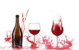 Glass with red wine splash. On white background royalty free stock photos