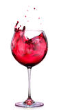 Glass of red wine with splashes isolated on a white Royalty Free Stock Image