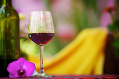 Glass with red wine on the table Stock Photos