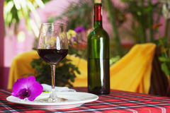 Glass with red wine on the table Stock Photo