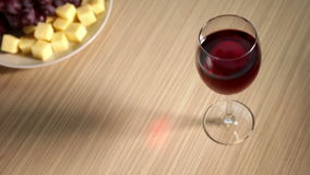 Glass of Red Wine on the Table stock footage