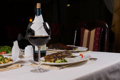Glass of Red Wine on Table with Dinner Royalty Free Stock Photos