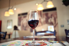 Glass with red wine on table Royalty Free Stock Photo