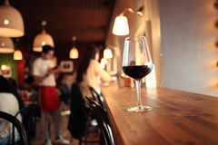 Glass with red wine at table Royalty Free Stock Photos
