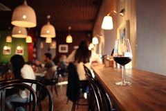 Glass with red wine at table Stock Photography