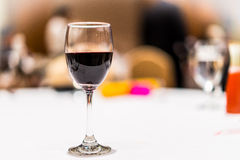 Glass of red wine on the table. Stock Photo