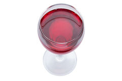 A glass of red wine is a top view. Alcoholic drink on a white background. royalty free stock photography