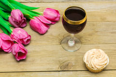 Glass with red wine and tulips Royalty Free Stock Photo