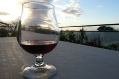 Glass of red wine under the tropic. Glass of red wine somewhere in paradise Royalty Free Stock Photography