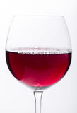 Glass of red wine view close-up. Glass of red wine close-up over white background Royalty Free Stock Images
