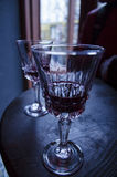 A glass of red wine on vintage wine table, cherry. ! royalty free stock photos