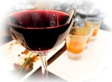 Glass of red wine after wine testing party. Choose the best taste for red meat food in dinner party. Selected focus Royalty Free Stock Image