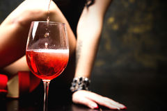 Glass of red wine on wooden table Stock Photo