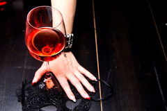 Glass of red wine on wooden table Stock Images