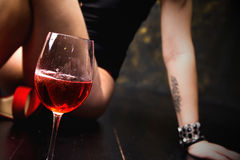 Glass of red wine on wooden table Royalty Free Stock Photo