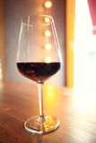 Glass with red wine on wooden table Stock Images