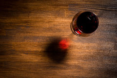 Glass of red wine on wooden table. Top view Royalty Free Stock Image