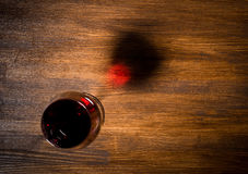 Glass of red wine on wooden table. Top view Royalty Free Stock Photography