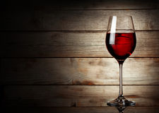 Glass of red wine on a young Royalty Free Stock Image