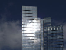 Glass Reflection. Modern glas  building against clear blue sky with sun reflection in windows Stock Images