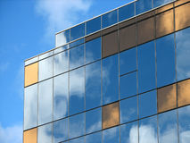 Glass reflections. Glass exterior reflecting the sky and clouds stock photography