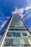 Glass reflective office buildings against blue sky   Royalty Free Stock Image