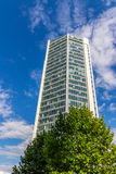 Glass reflective office buildings against blue sky   Royalty Free Stock Photos