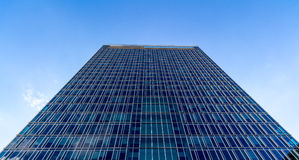 Glass reflective office buildings against blue sky   Royalty Free Stock Images