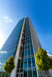 Glass reflective office buildings against blue sky   Stock Image