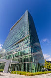 Glass reflective office buildings against blue sky   Stock Photography