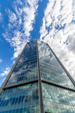 Glass reflective office buildings against blue sky with clouds and sun light Stock Photos