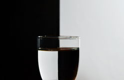 Glass with refraction light in black and white background Royalty Free Stock Photo