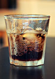 Glass of refreshing beverage. Cold  carbonated refreshing drink with ice cubes Stock Image
