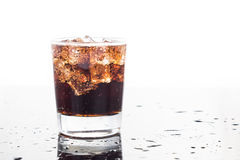 A glass of refreshing cold fizzy cola drinks Stock Photos