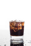 A glass of refreshing cold fizzy cola drinks in vertical orientation Stock Photos