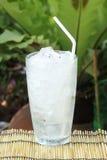 Glass of refreshing ice cube Stock Photo