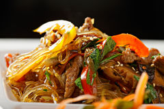 Glass rice noodles served with beef closeup Stock Photos