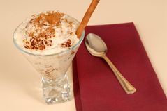Glass of rice pudding with cinnamon Stock Image