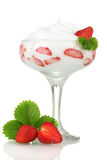 Glass of ripe strawberries with cream Royalty Free Stock Photos